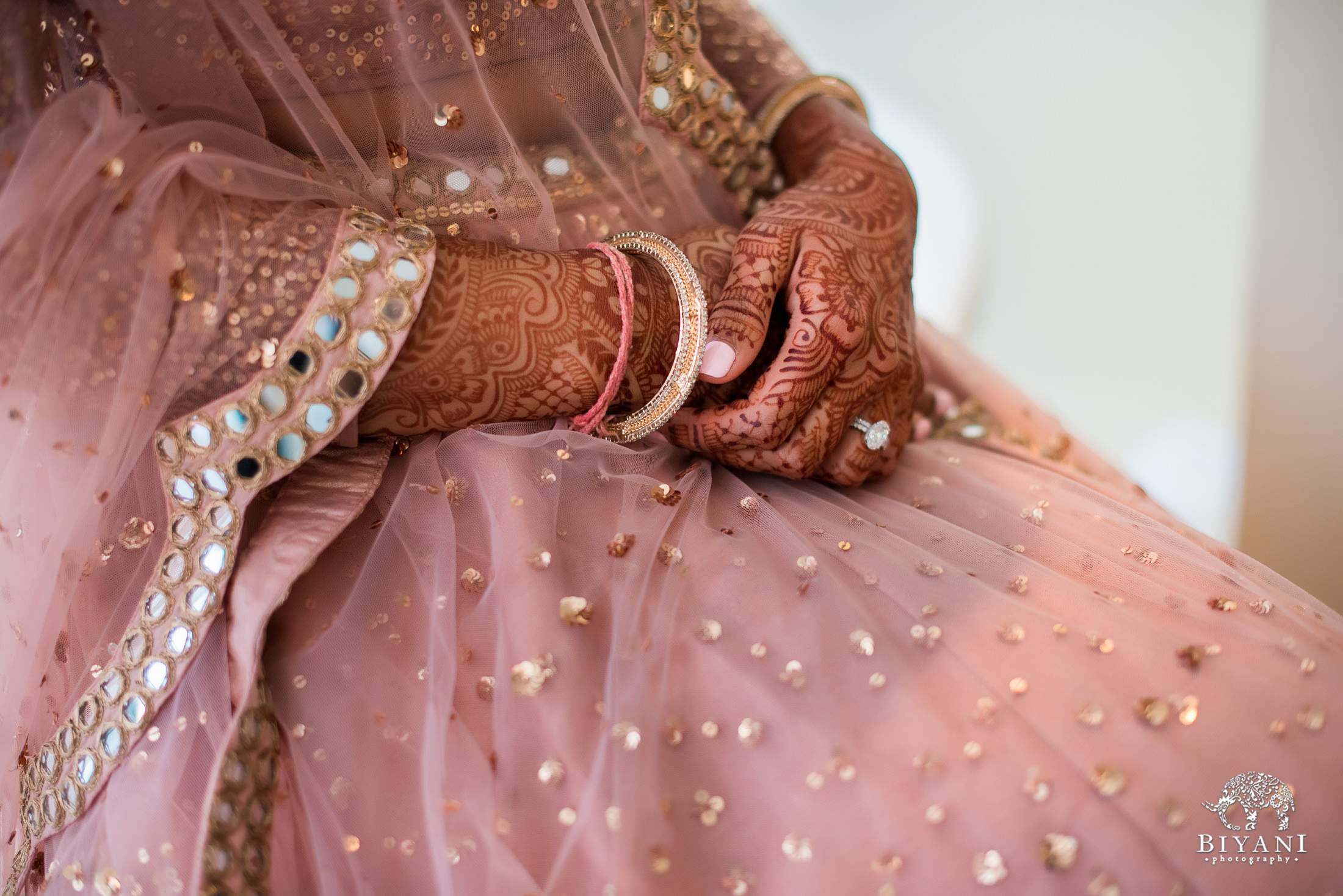 Bride's wedding ring close up in her reception outfit