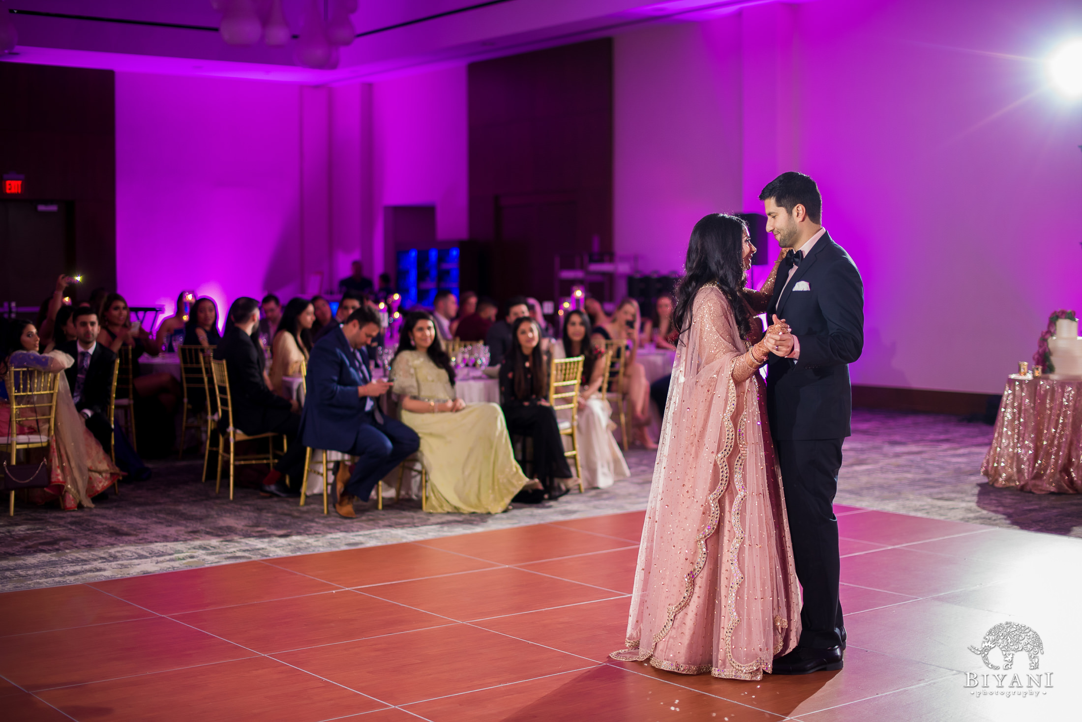couple facing each other during their first dance at the reception