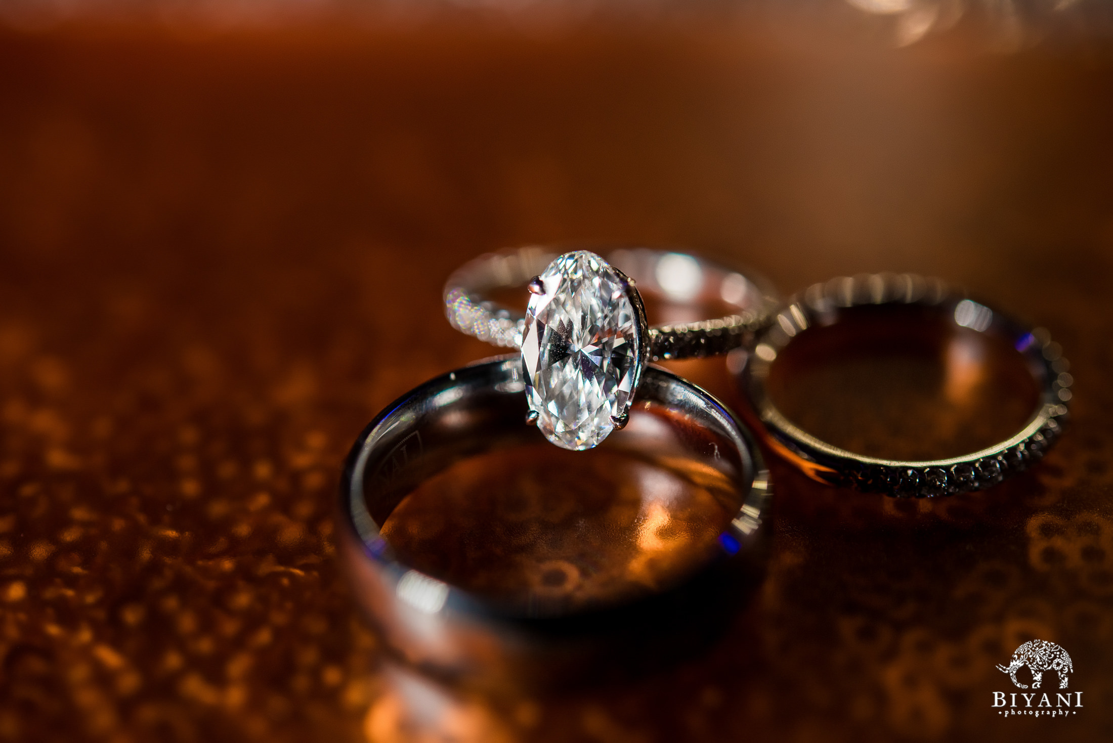 close up detail shot of engagement rings and wedding bands of bride and groom