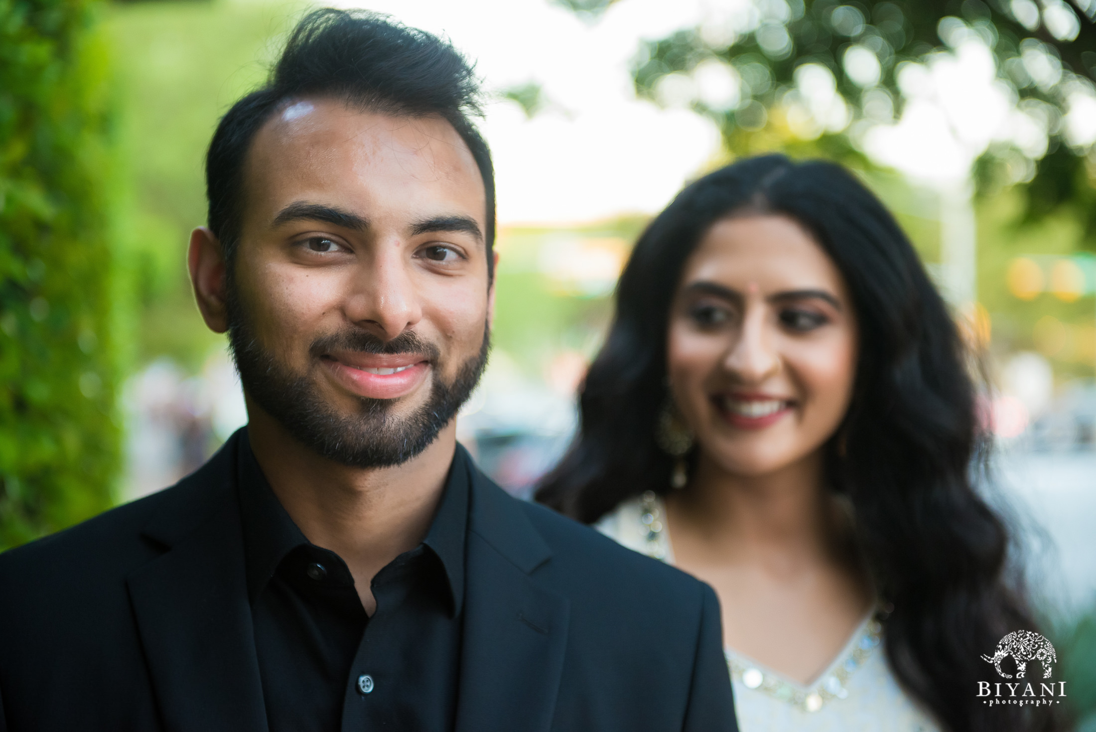 bride and groom posing on the streets of Austin, Texas during Indian Engagement photo shoot