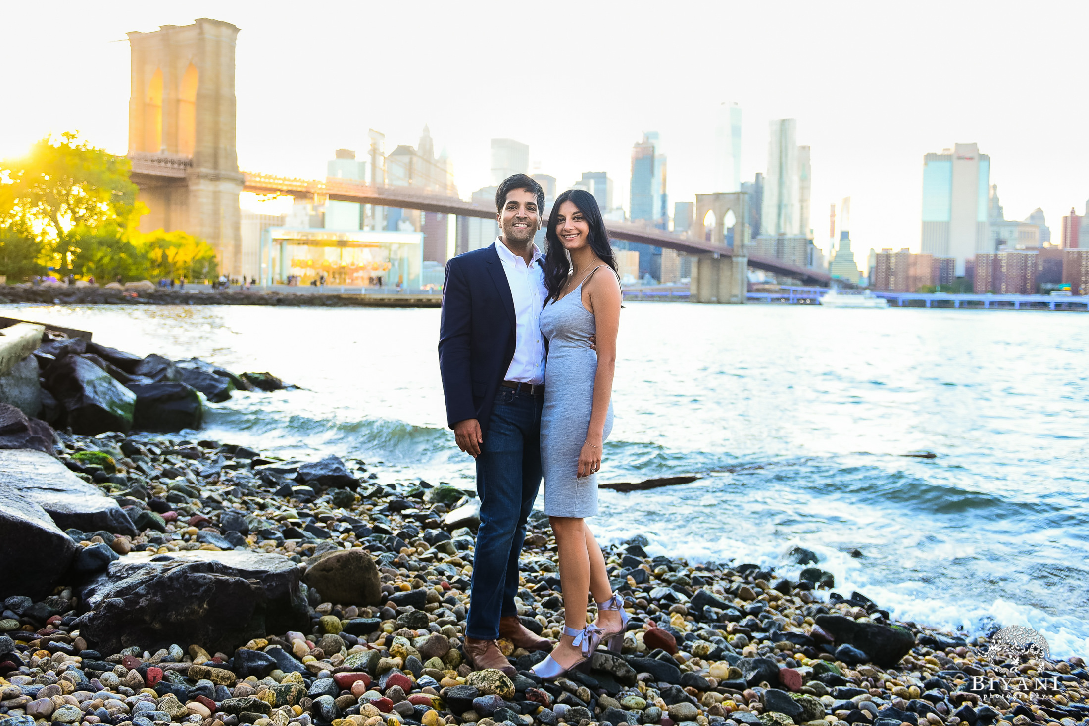 couple standing in front of Brooklyn Bridge in New York City
