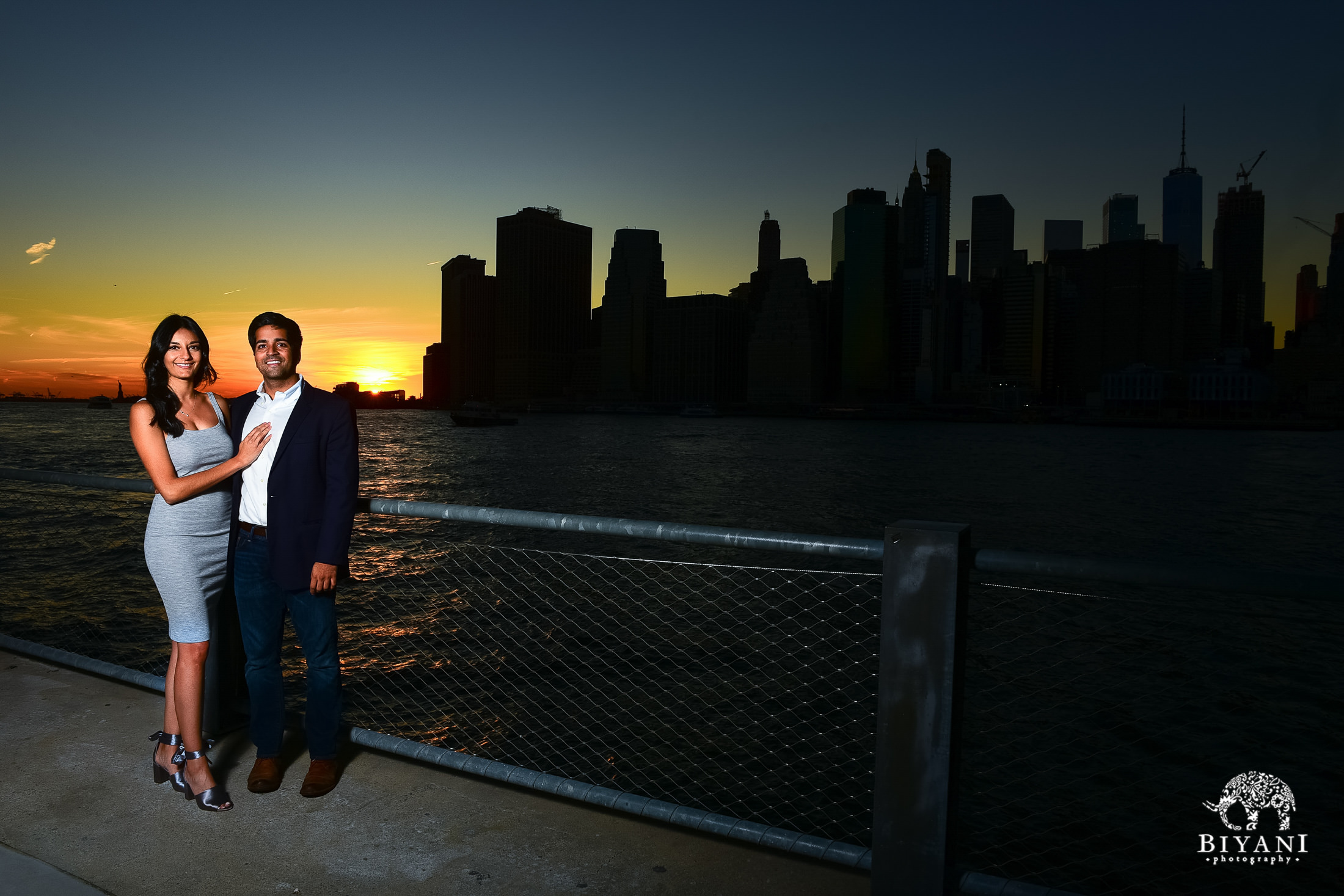 couple in front of New York City skyline at sunset