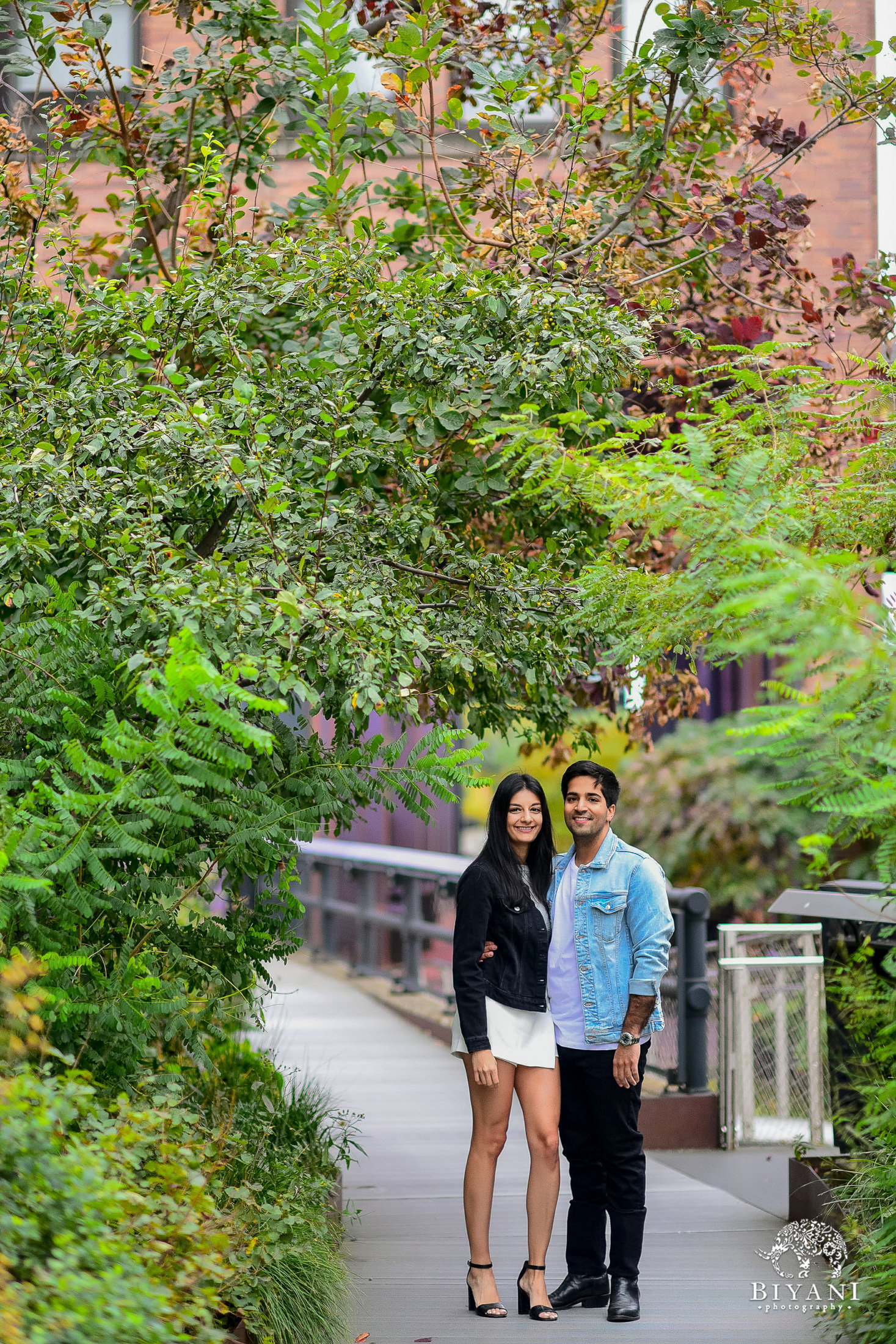 couple standing under large ivy growth in New York City